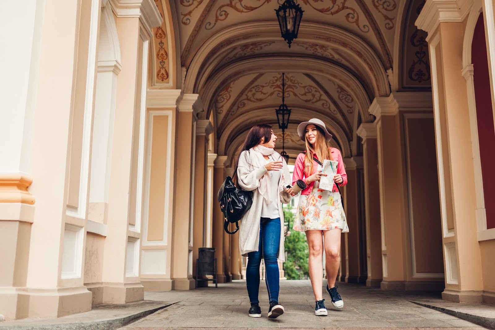 Early action vs early decision: Two college girls walking and talking