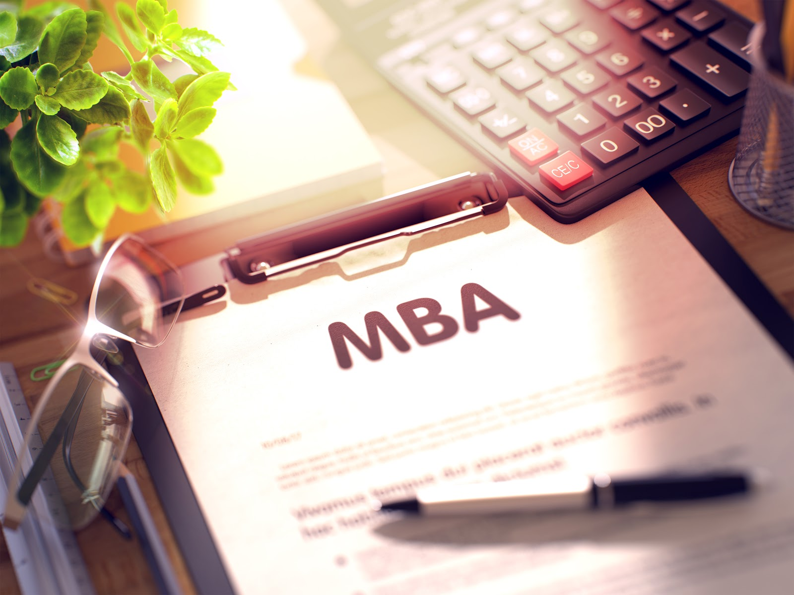 Is an MBA worth it: MBA form on top of table placed on clipboard