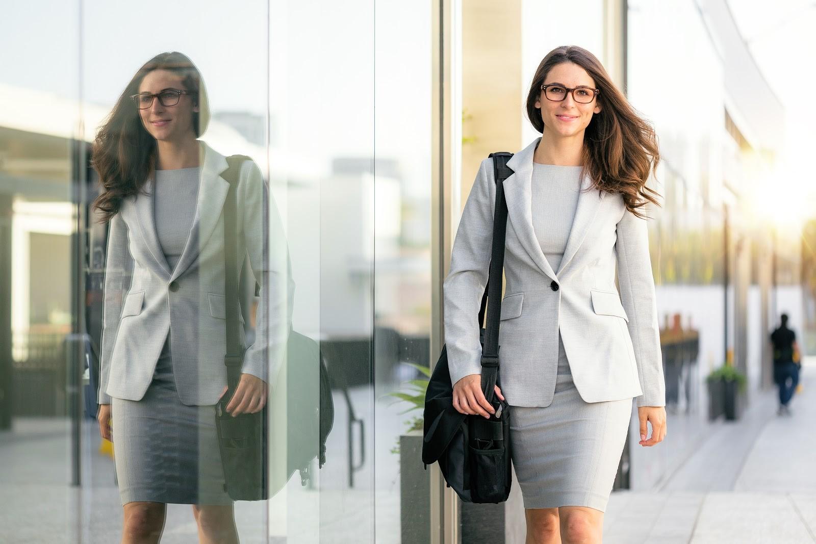 Is an MBA worth it: Woman walking along the street
