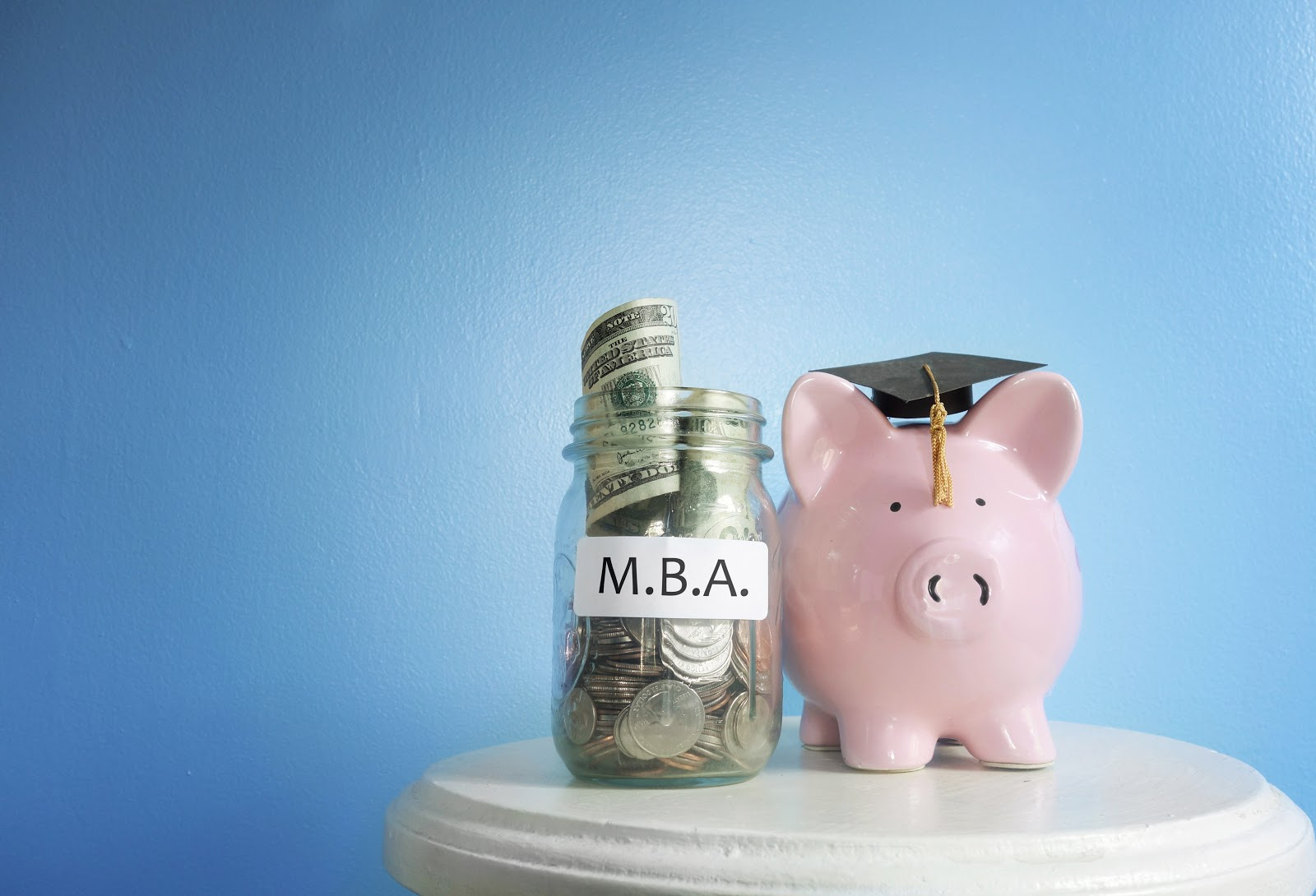Is an MBA worth it: A jar of money and piggy bank