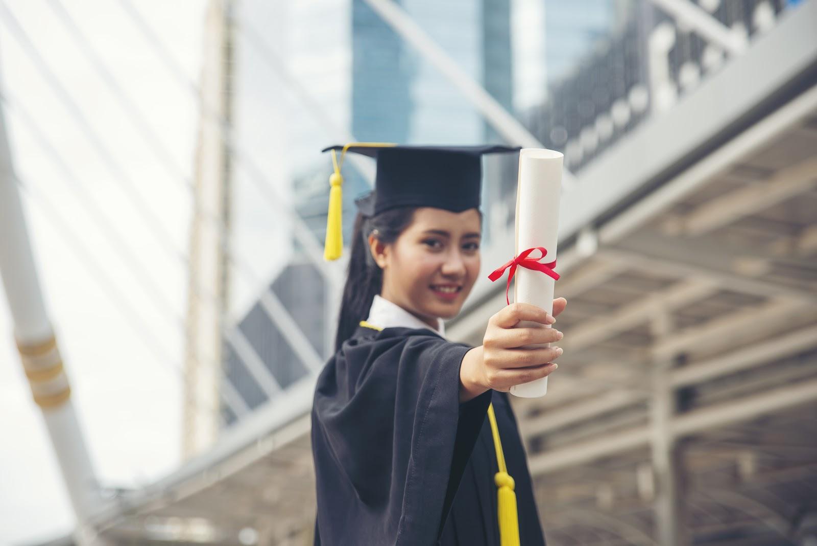 Graduate woman holding a diploma