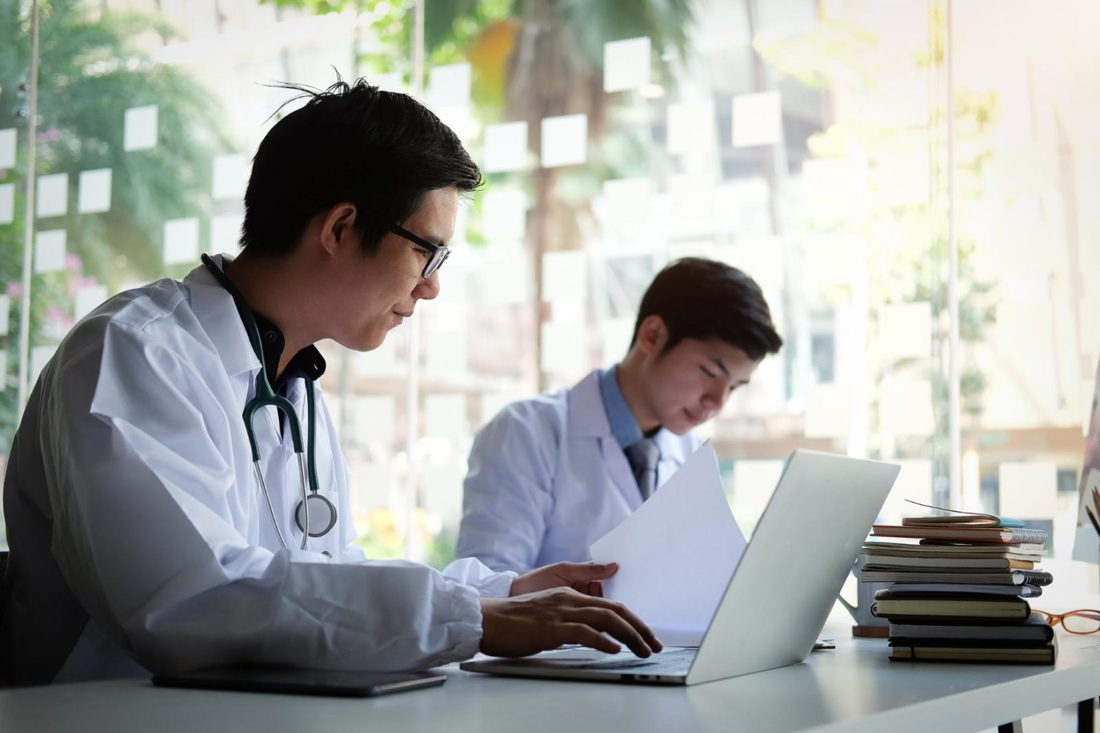 doctorate degree: doctor and nurse checking a patient's medical record on a clipboard