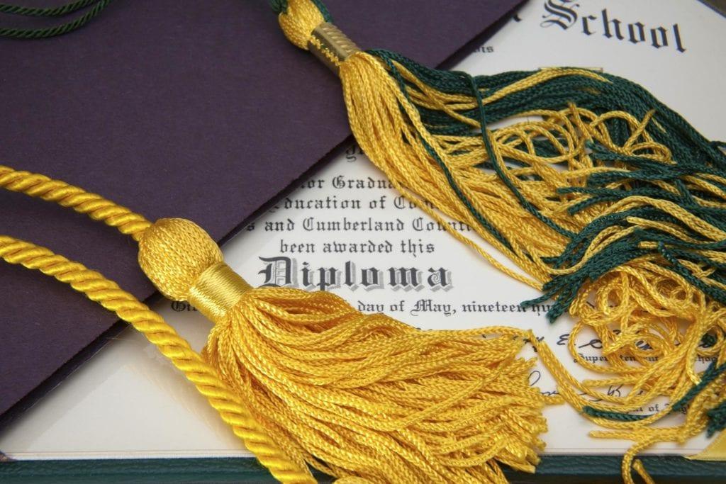 Doctorate vs PhD: Diploma and tassel