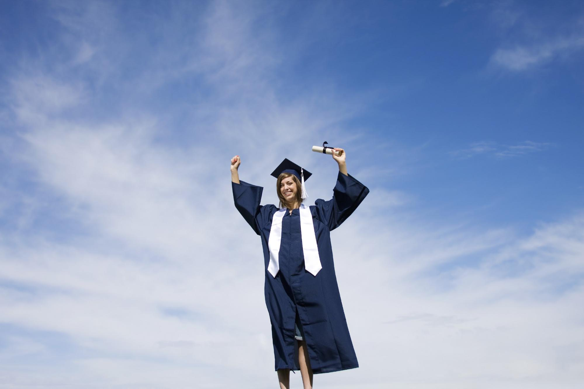 Associate's degree: Female student wearing a gown celebrating her graduation