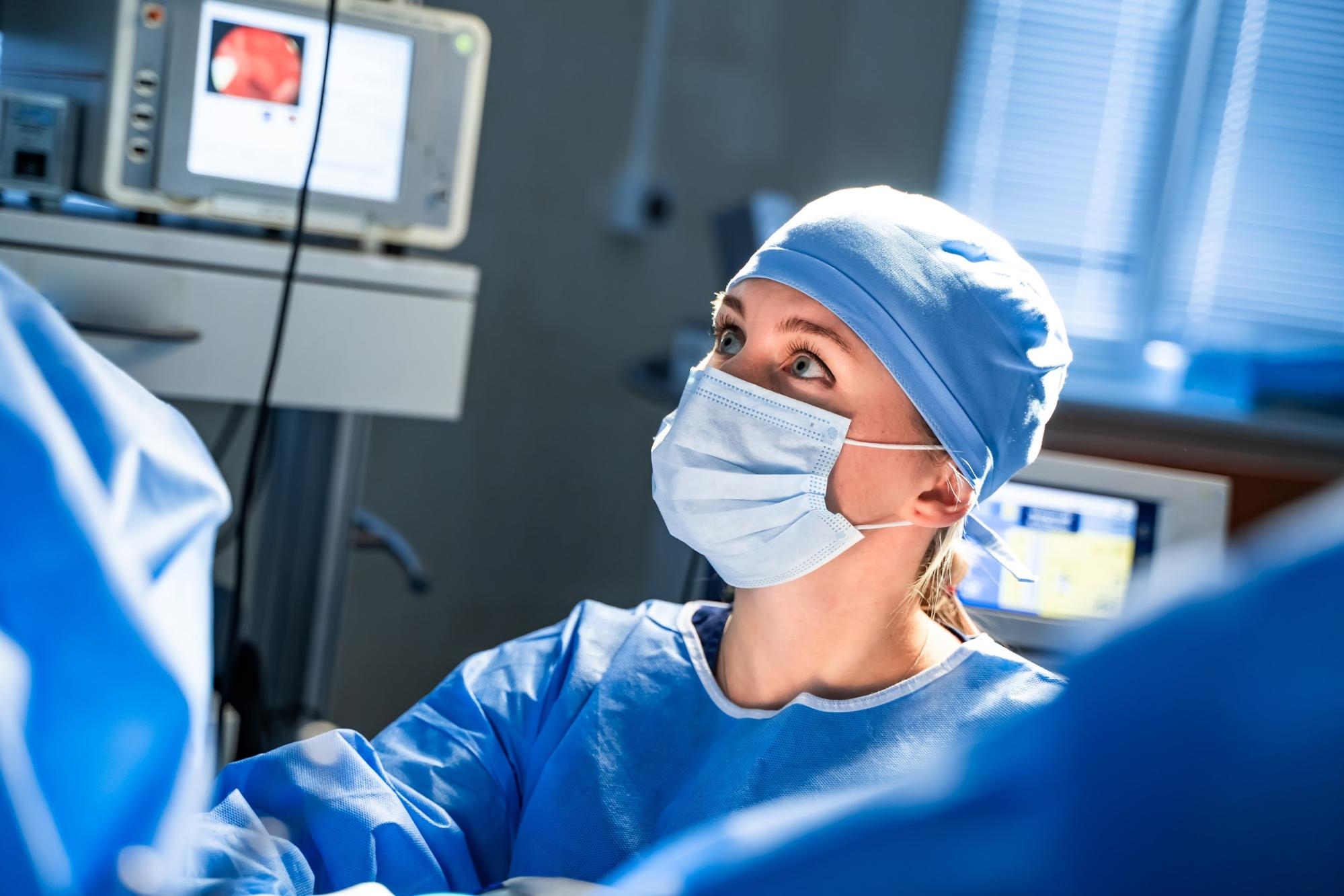 Best careers for the future: Nurse wearing mask assisting a surgery operation